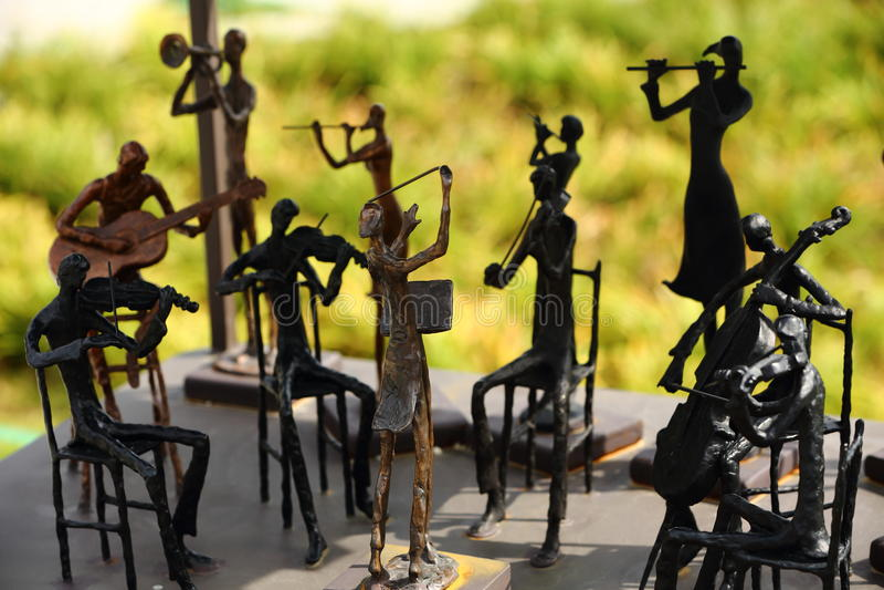 A metal men band. Of handicraft stock images