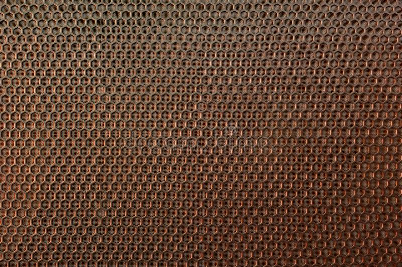 The metal mesh. Background. Texture. Bronze shade. The metal mesh. Background. Texture for design. Bronze shade royalty free stock photo