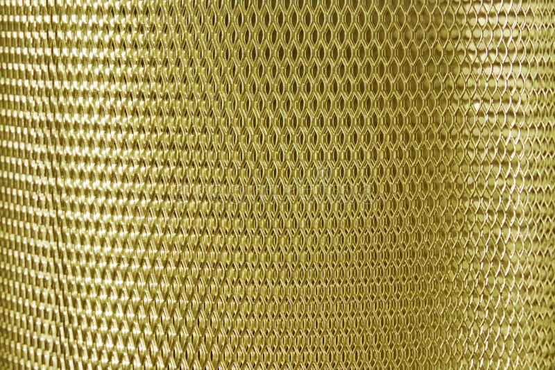 Metal mesh grate gold royalty free stock images