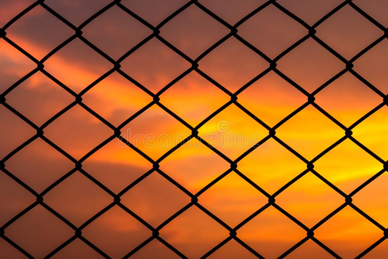 Metal mesh pattern with dramatic sky background stock image