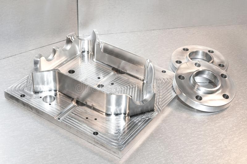 Metal mold and steel flanges. Milling industry. CNC technology. Metal mold/blank and steel flanges. Milling and drilling industry. CNC technology. Mechanical stock image