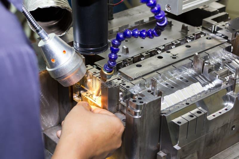 Metal mold and die part repair by welder with laser welding method.  stock image