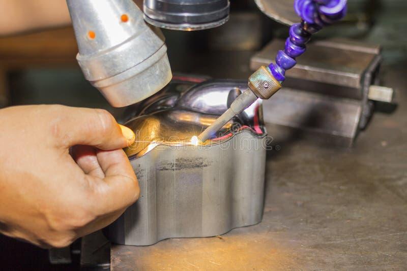 Metal mold and die part repair by welder with laser welding method.  stock photos