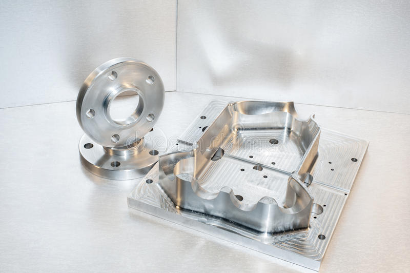 Metal mold and steel flanges. Milling industry. Metal mold/blank and steel flanges. Milling industry. CNC technology stock image