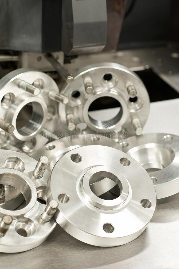 Metal mold of wheel spacers and bolts. CNC industry royalty free stock photo