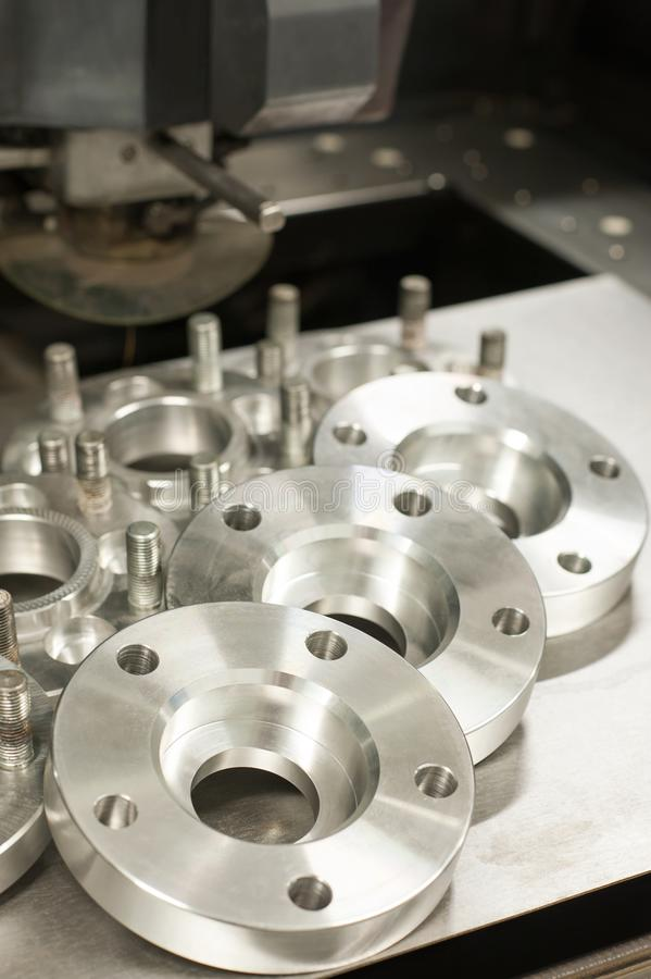 Metal mold of wheel spacers and bolts. CNC industry stock images