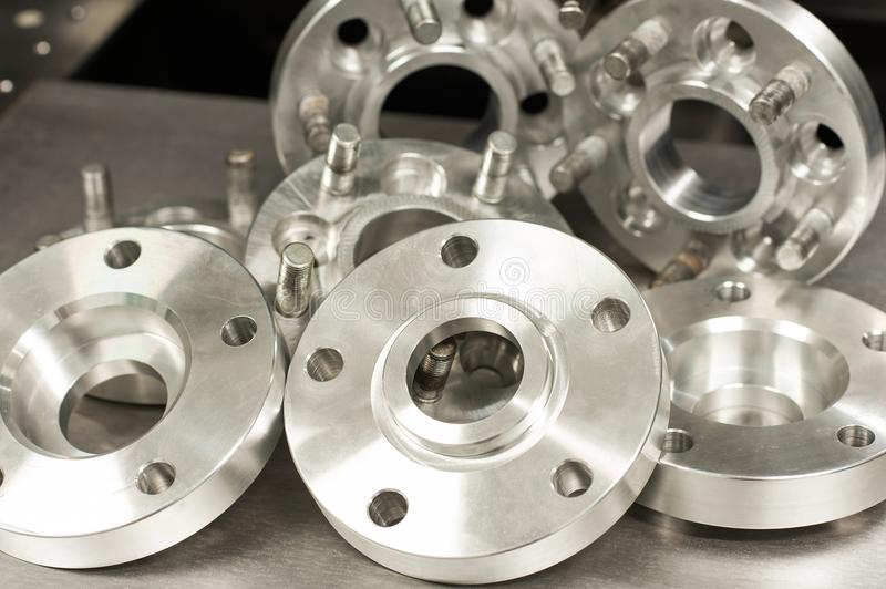 Metal mold of wheel spacers and bolts. CNC industry stock photos