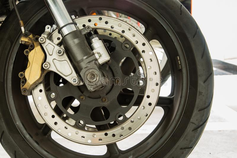 Metal motorbike front wheel closeup view stock photos