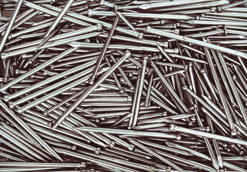 Metal nails close up, isolated industrial seamless background royalty free stock photo