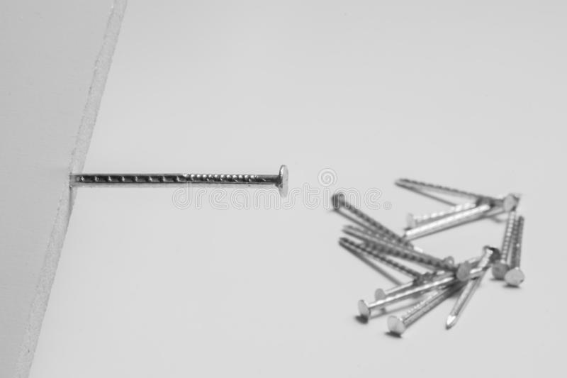 Metal nails isolated on white background. working tools royalty free stock photo
