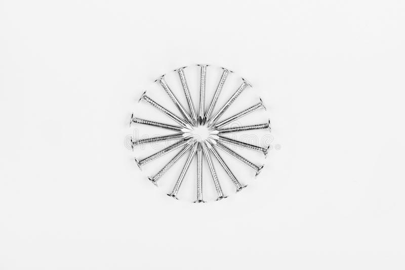 Metal nails on a white background. Metal nails lined circle on a white background stock images