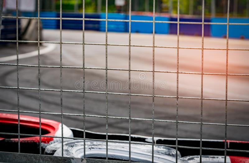 Metal net fence behind tire protection for racing car crash in r stock photo