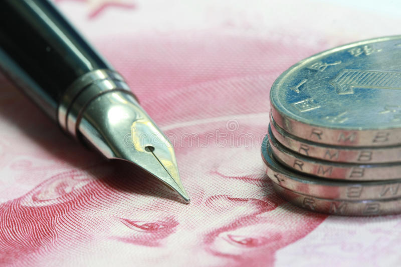 Metal Nib Pen on china money. Bill and coin stock images