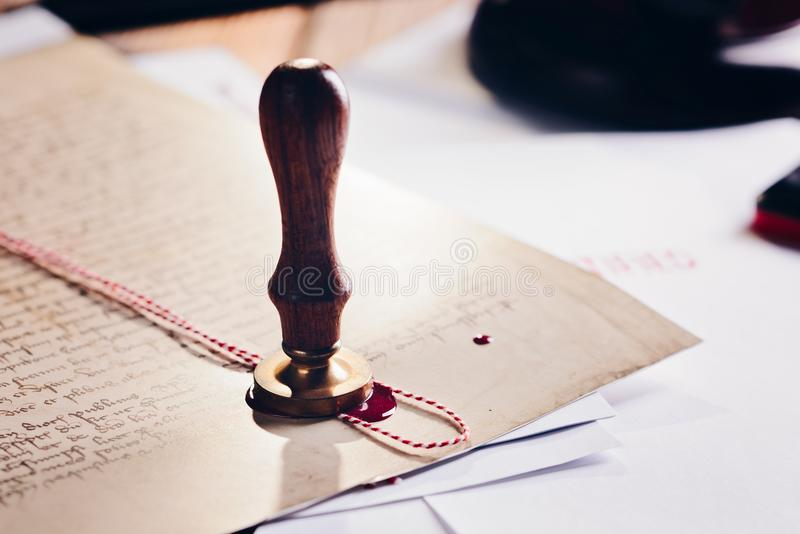 Metal notary public wax stamper on old document royalty free stock photography