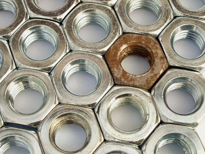 Metal nuts arranged in a plane royalty free stock images