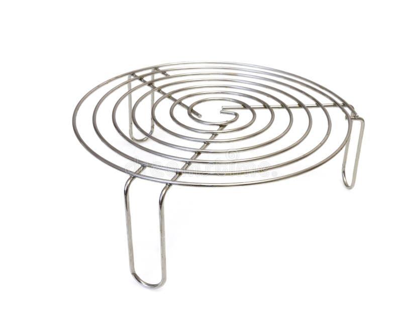 Metal o tripé para os utensílios de mesa quentes isolados no fundo branco fotografia de stock royalty free