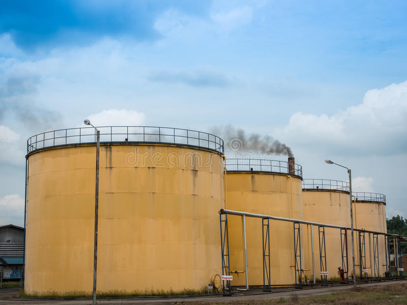 Metal oil tanks in Palm oil refinery plant . Metal oil tanks in Palm oil refinery plant and puffs of smoke, Thailand stock photos