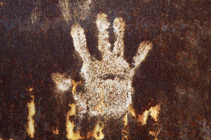 Metal oxidado com handprint imagem de stock royalty free