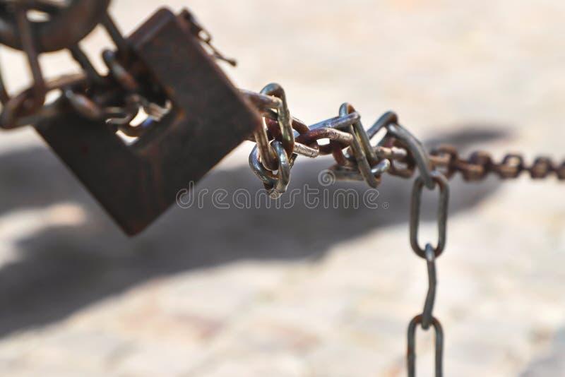 Metal padlock and chain link. Metal padlock and chain link, closeup stock photos