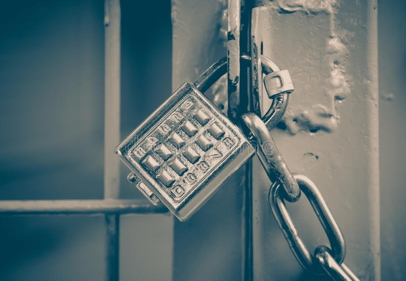 Metal padlock and pin keypad with numbers royalty free stock image