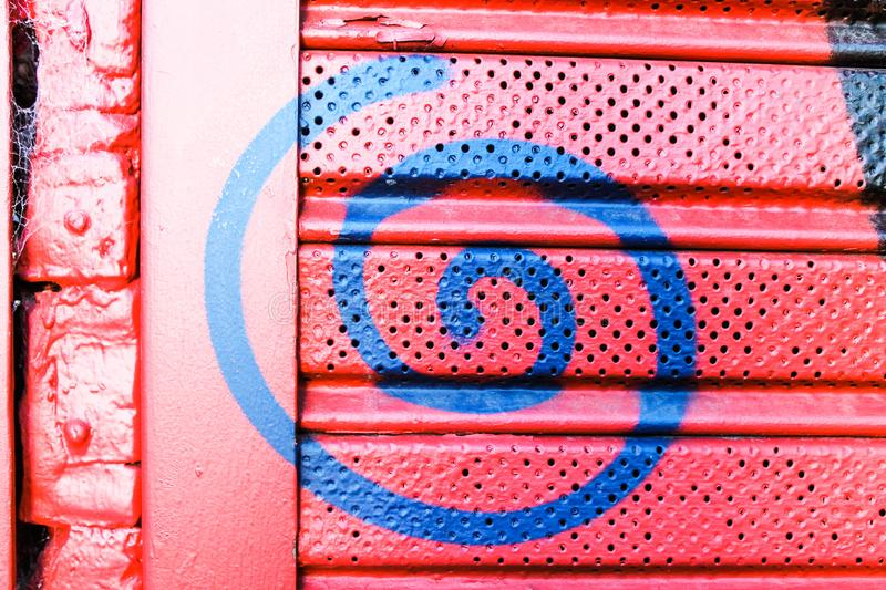 Metal Painted Shutter Red Colorized Texture Service. Spiral Metallic Painted stock photography
