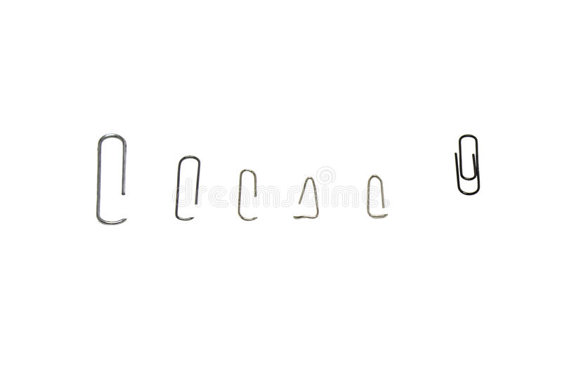Metal paper clips. Several species on both sides, isolated royalty free illustration