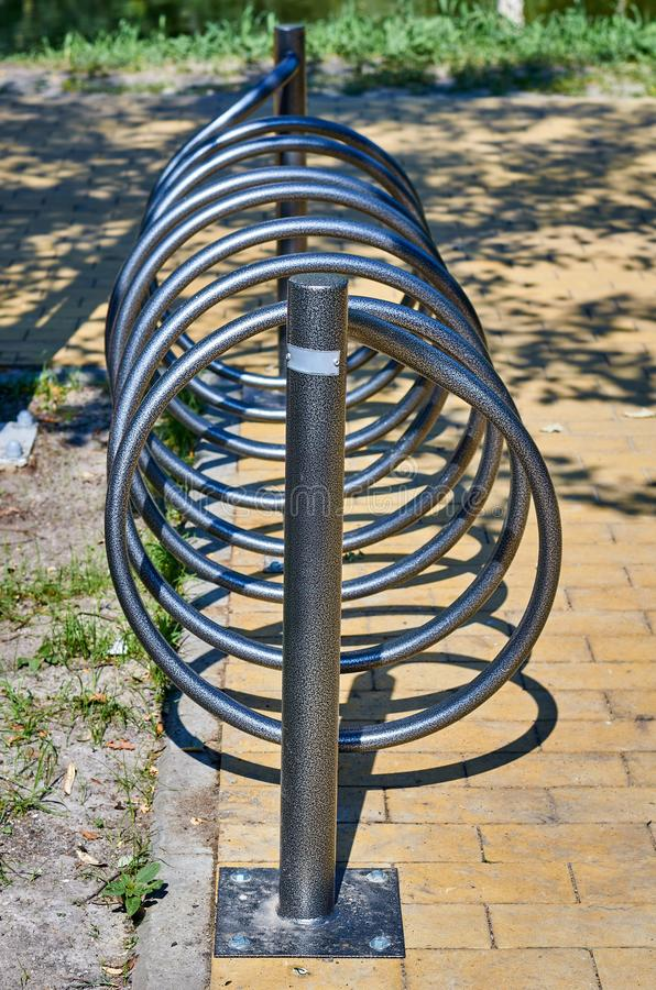 Metal parking for bicycles in the city park stock images
