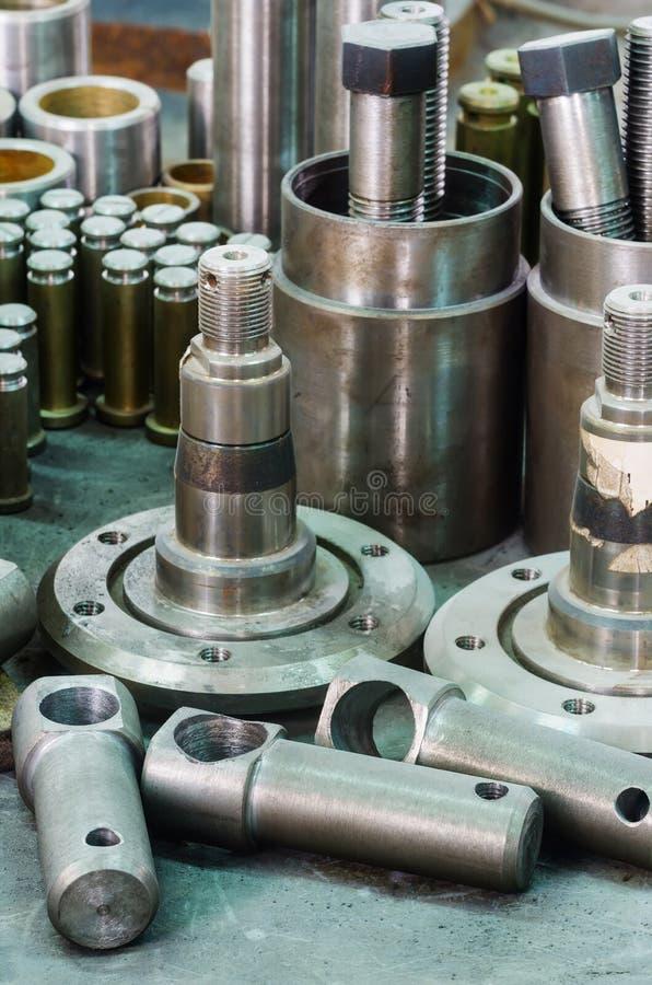 Metal parts, hub, screws, bushings, pins stock photo