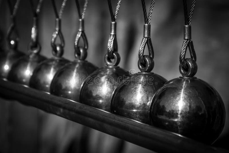 Newton Cradle Metal Pendulum Balls Aligned Black And White stock images