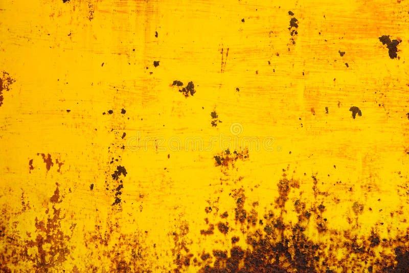 Metal pintado amarillo aherrumbrado Fondo matal de la textura abstracta foto de archivo