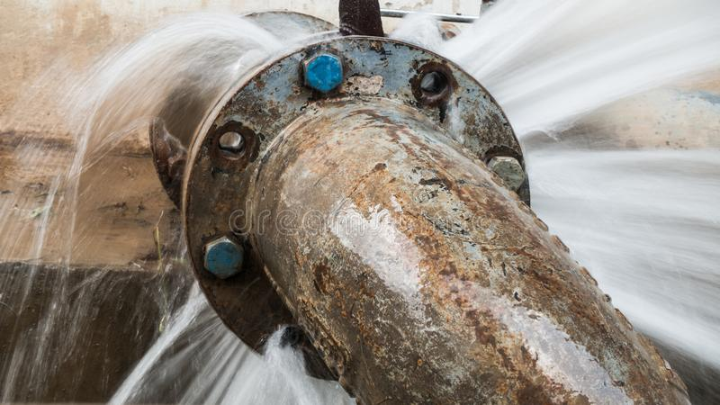 Metal pipe with valve is leaking in water treatment plant royalty free stock photo