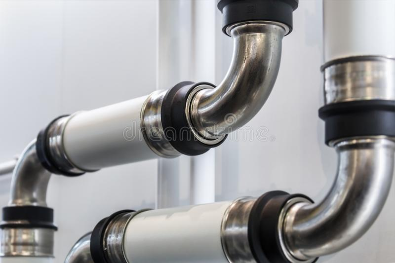 Metal pipes, couplings and fittings. Plumbing, fixing pipes and fittings for connection royalty free stock image