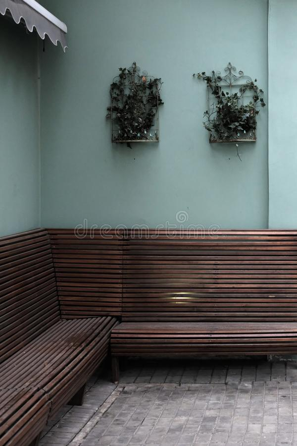 Metal planter with green plants on wall. Rustic royalty free stock images