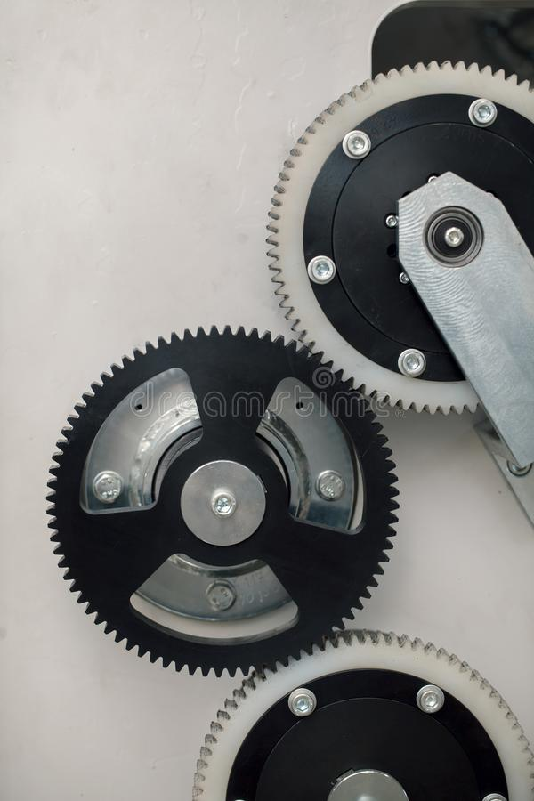 Metal and plastic gears royalty free stock image