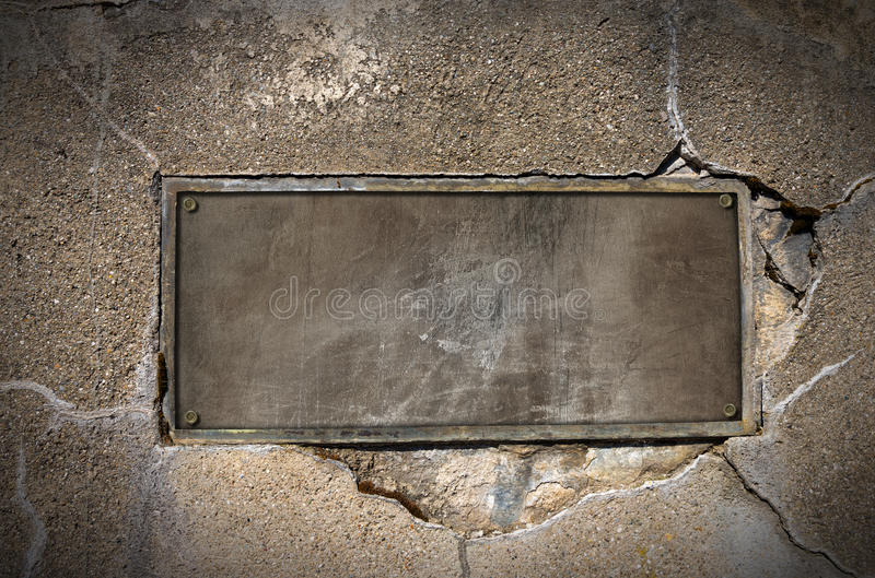 Metal Plate on Concrete Wall royalty free stock photos