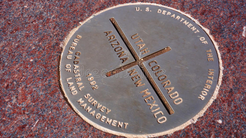 Metal plate of Four Corners in USA. The Four Corner consists of 4 different stats of USA stock images