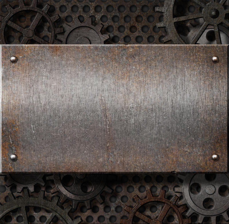 Metal plate over rusty gears background stock photography
