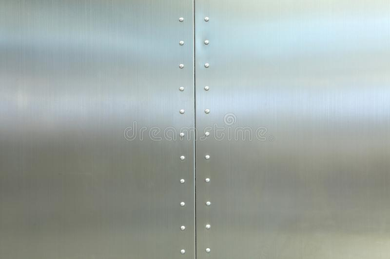 Metal plate with screws background stock image