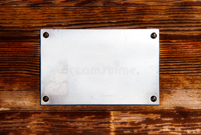 Metal Plate On A Wood Royalty Free Stock Photography