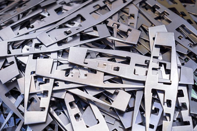 Metal plates after processing on die-cutting press.  royalty free stock image