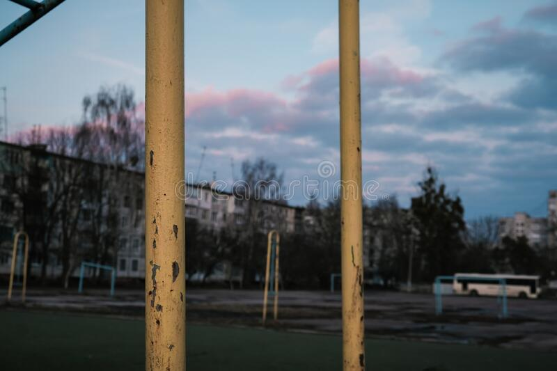 metal playground with bars against the background of sunset stock photo