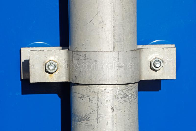 Metal pole with fixing clamps royalty free stock photography