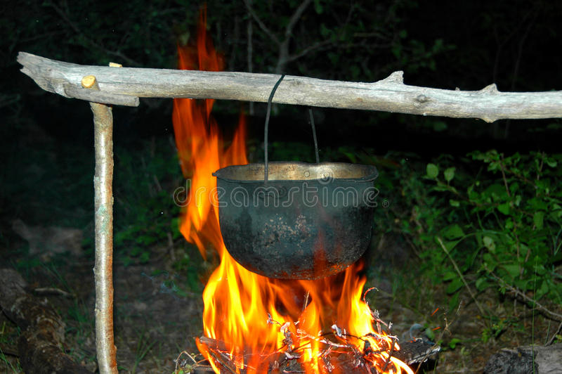 Metal Pot Under A Fire Royalty Free Stock Photography
