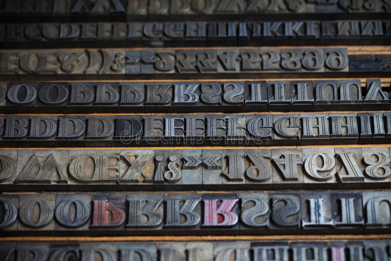 Metal printing press letters stock images