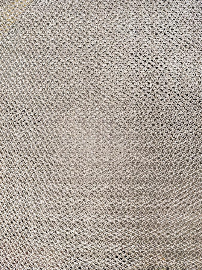 Metal production mesh with small holes, silver color, interlacing aluminum filaments. royalty free stock photos