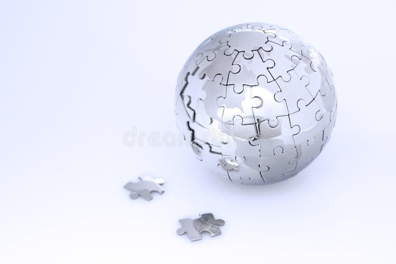 Metal puzzle globe royalty free stock photos