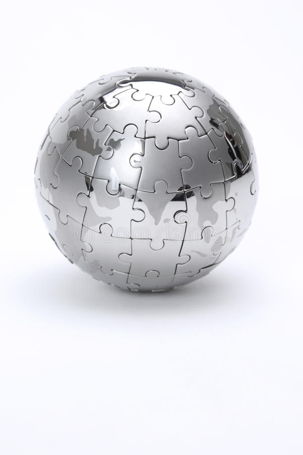 Metal puzzle globe. Isolated on white background royalty free stock photography