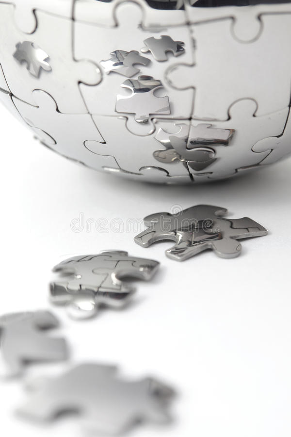 Metal puzzle globe close-up royalty free stock image