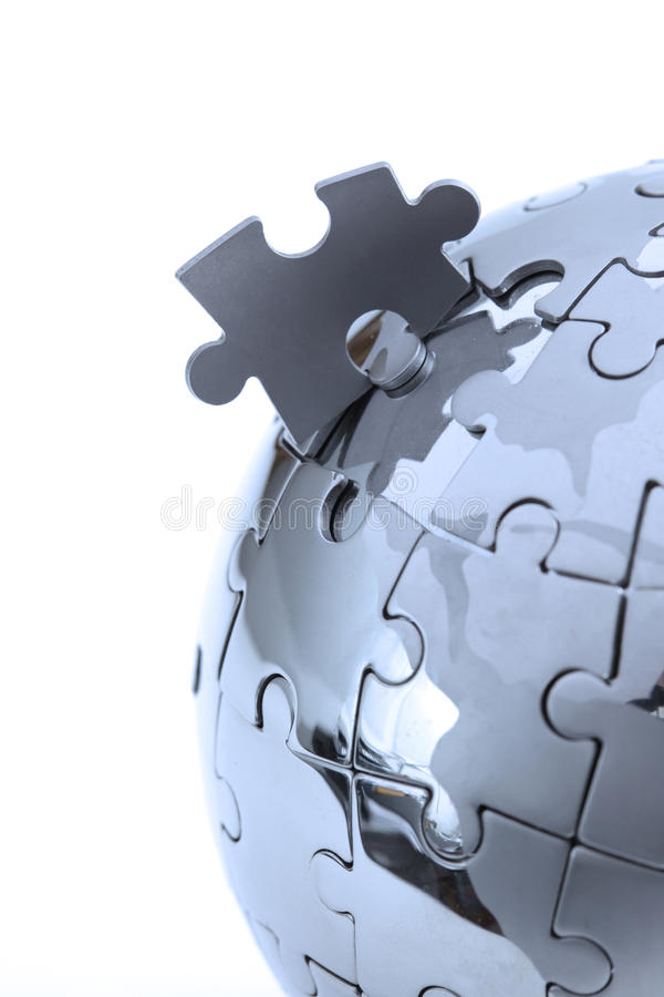 Metal puzzle globe, close-up in blue light royalty free stock photography