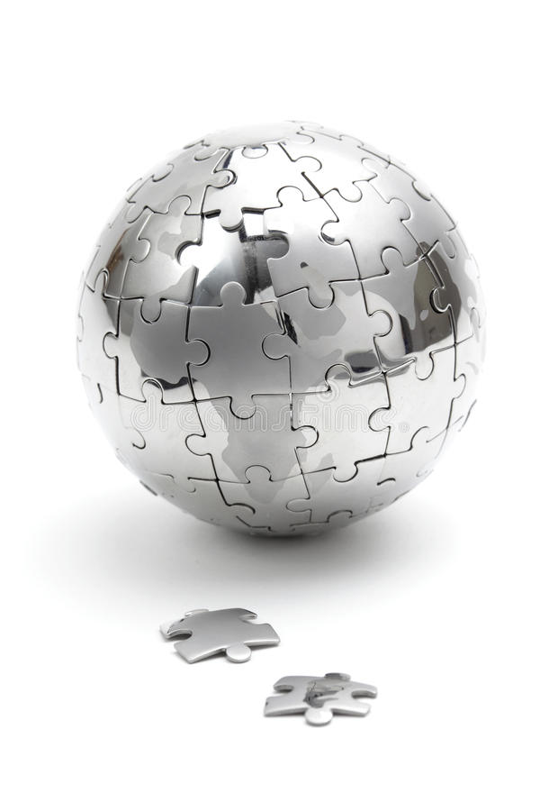 Metal puzzle globe on white background. Metal puzzle globe isolated on white background stock photo